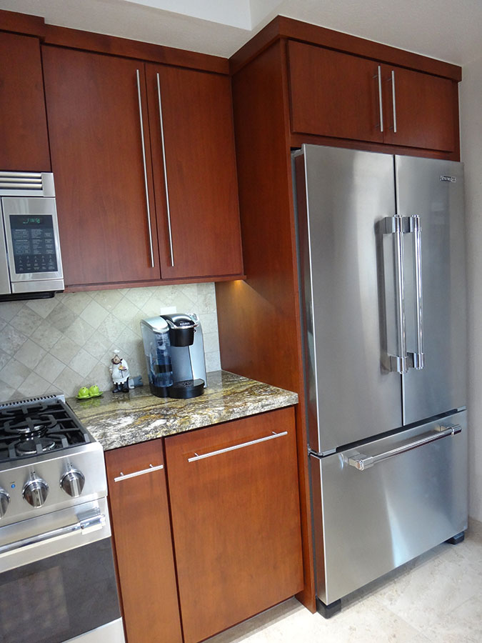 Full depth refrigerator cabinet with side enclosure panel ...