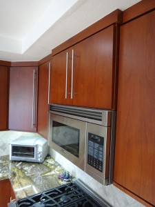 Step-out cabinet above microwave